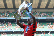Saracens lock Maro Itoje (6) holds the trophy above his head during the Gallagher Premiership Rugby Final match between Exeter Chiefs and Saracens at Twickenham, Richmond, United Kingdom on 1 June 2019.