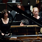 """January 18, 2012 - Manhattan, NY : The pianist Lang Lang, foreground at piano, and the New York Philharmonic perform Bartók's """"Piano Concerto No. 2, BB 101 (1930-31)"""" at Lincoln Center's Avery Fisher Hall on Wednesday evening. CREDIT : Karsten Moran for The New York Times"""