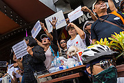 24 MAY 2014 - BANGKOK, THAILAND: People protest against the Thai military coup at the entrance to a shopping mall in Bangkok. There were several marches in different parts of Bangkok to protest the coup that unseated the popularly elected government. Soldiers and police confronted protestors and made several arrests but most of the protests were peaceful. The military junta also announced that firing of several police commanders and dissolution of the Thai Senate. The junta also changed its name from National Peace and Order Maintaining Council (NPOMC) to the National Council for Peace and Order (NCPO).   PHOTO BY JACK KURTZ