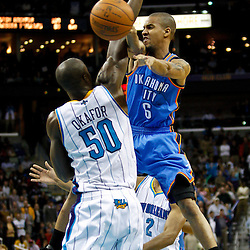 January 24,  2011; New Orleans, LA, USA; Oklahoma City Thunder point guard Eric Maynor (6) passes the ball past New Orleans Hornets center Emeka Okafor (50) during the fourth quarter at the New Orleans Arena. The Hornets defeated the Thunder 91-89. Mandatory Credit: Derick E. Hingle