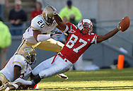 RALEIGH NORTH CAROLINA: Georgia Tech's   Kenny Scott (2) and Dawan Landry (20) stop NC State's Brian Clark (87) from getting a  first down in the fourth quarter on Saturday, 11/06/04 at NC STATE.  Georgia Tech won the game 24 to 14.©2004 Johnny Crawford