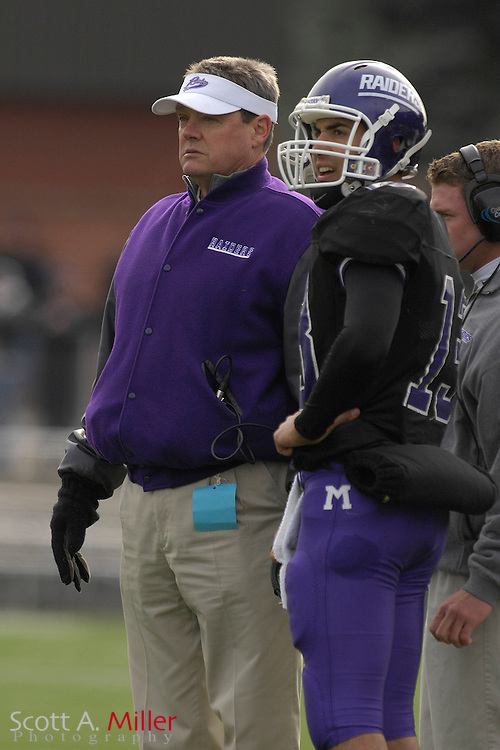 Nov. 24, 2007; Alliance, OH, USA;  Mount Union Purple Raiders coach Larry Kehres and quarterback Greg Micheli (13) during the Purple Raiders' 59-7 win over the College of New Jersey Lions in the second round of the Division III playoffs at Mount Union Stadium. Hired prior to the 1986 season, Kehres has the highest winning percentage of any head coach in modern college football history. He is the winningest active coach in terms of percentage in NCAA history. Through the second round of the 2007 playoffs, coach Kehres has a record of 258-20- 3. Under Kehres, the Raiders have won nine Division III National Championships in the last 14 years ('93, '96, '97, '98, '00, & '01, '02, '05, '06)....©2007 Scott A. Miller