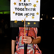 """A protester exhibits a sign reading """"Stand Together For Hope"""" during June protests in Hong Kong. Protesters are opposed to a controversial extradition bill."""