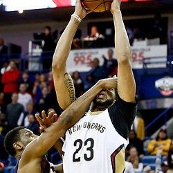 Dec 15, 2016; New Orleans, LA, USA; New Orleans Pelicans forward Anthony Davis (23) is fouled by Indiana Pacers forward Thaddeus Young (21) during the fourth quarter of a game at the Smoothie King Center. The Pelicans defeated the Pacers 102-95. Mandatory Credit: Derick E. Hingle-USA TODAY Sports