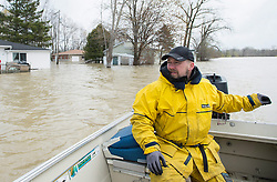 Chris Amerides makes his way home in a boat along the Rigaud River, west of Montreal, Monday, May 8, 2017, following flooding in the region. Photo by Graham Hughes /The Canadian Press/ABACAPRESS.COM