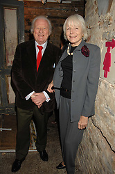 VISCOUNT & VISCOUNTESS NORWICH at a reception to Discover Wilton's Music Hall held at the hall in Graces Alley, London E1 on 5th December 2007.<br />