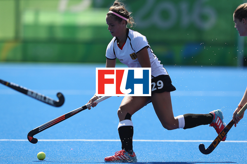 RIO DE JANEIRO, BRAZIL - AUGUST 13:  Pia-Sophie Oldhafer of Germany runs with the ball during the Women's group A hockey match between the Netherlands and Germany on Day 8 of the Rio 2016 Olympic Games at the Olympic Hockey Centre on August 13, 2016 in Rio de Janeiro, Brazil.  (Photo by David Rogers/Getty Images)