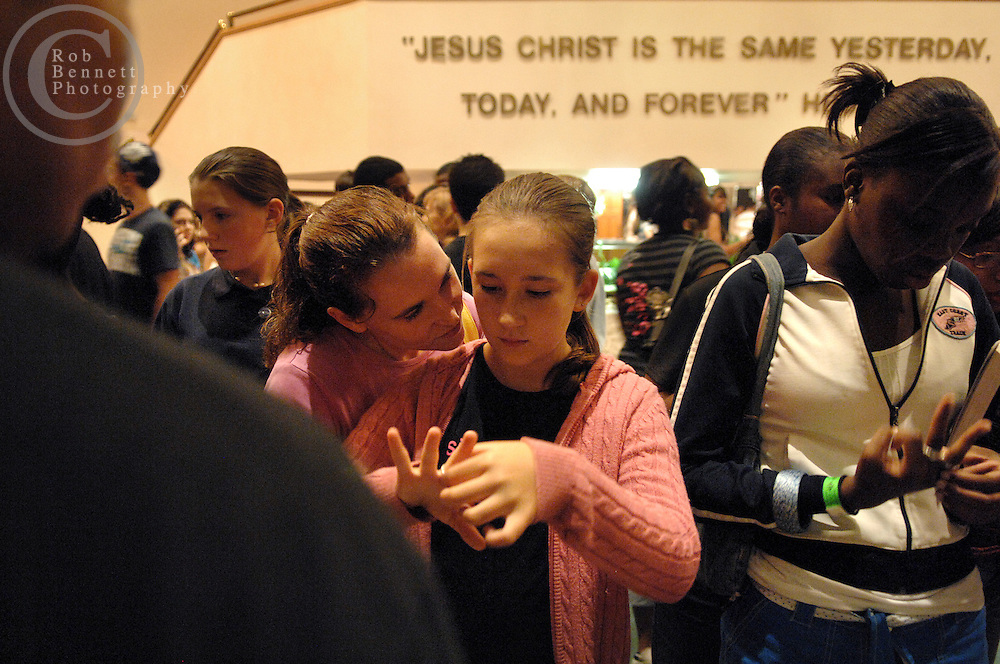"Here, 12-year old Kierstyn Savino of North Haledon, NJ is fitted for and puts on her ""silver ring"" following the event. She is accompanied by her mother, Brenda Savino..---.Wayne, NJ - Friday, Sept. 7, 2007  - As part of an interview with the author Tom Perrotta, we document his attendance at an abstinence event called ""Silver Ring Thing"" at Calvary Temple in Wayne, NJ in which students (grades 6-12 & college) are encouraged to live an abstinent lifestyle until marriage, signified by the wearing of a silver ring. Abstinence and sex education is the subject of Perrotta's next novel, The Abstinence Teacher...Rob Bennett for the New York Times"