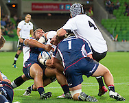 Schalk Ferreira (Kings) is tackled by Nic Henderson (Rebels) and Paul Alo-Emile (Rebels) with team mate Steven Sykes (Kings) trying to assist during the Round 9 match of the 2013 Super Rugby Championship between RaboDirect Rebels vs Southern Kings at AAMI Park, Melbourne, Victoria, Australia. 13/04/0213. Photo By Lucas Wroe