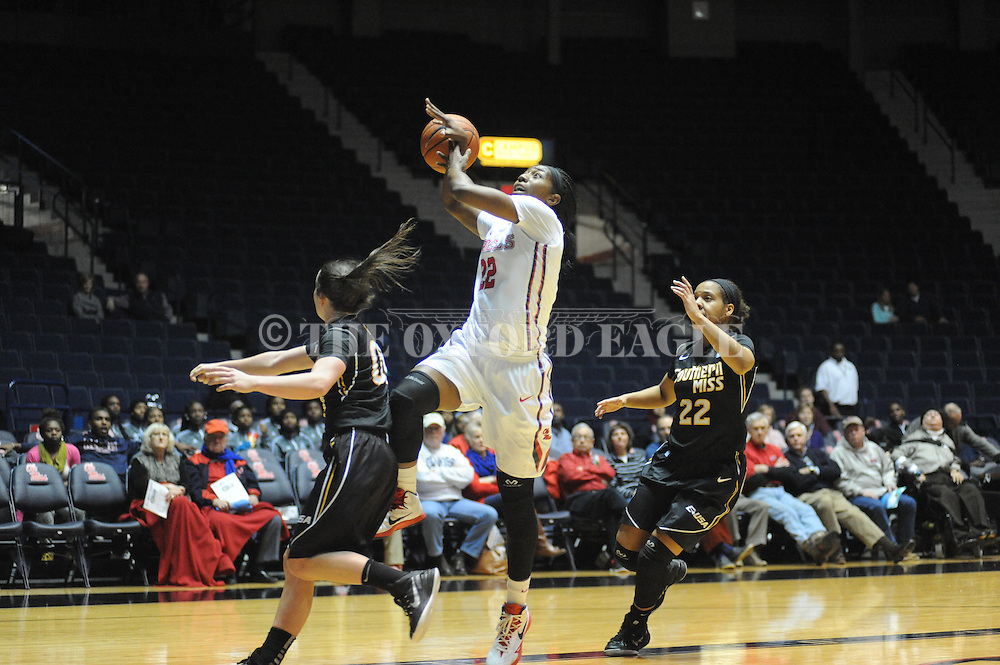 "Southern Mississippi Lady Golden Eagles guard Alex Coyne (00) knocks the ball away from Ole Miss Lady Rebels forward Danielle McCray (22) at the C.M. ""Tad"" Smith Coliseum in Oxford, Miss. on Thursday, December 18, 2014. (AP Photo/Oxford Eagle, Bruce Newman)"