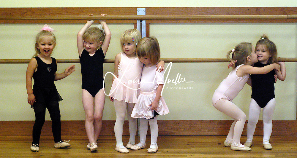 6/07/04 Little Ballerinas make friends at the bar during their first day of dance camp. L.MUELLER/The Charlotte Observer