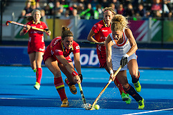 The Netherlands Maria Verschoor is tackled by Lieselotte Van Lindt of Belgium. The Netherlands v Belgium - Unibet EuroHockey Championships, Lee Valley Hockey & Tennis Centre, London, UK on 26 August 2015. Photo: Simon Parker