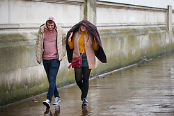 © Licensed to London News Pictures. 10/12/2017. London, UK. People walk on the Thames Embankment during a heavy snowfall in London on Sunday, 10 December 2017. Photo credit: Tolga Akmen/LNP