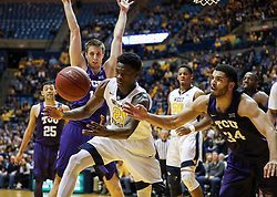 Feb 12, 2018; Morgantown, WV, USA; West Virginia Mountaineers forward Wesley Harris (21) and TCU Horned Frogs guard Kenrich Williams (34) fight for a rebound during the second half at WVU Coliseum. Mandatory Credit: Ben Queen-USA TODAY Sports