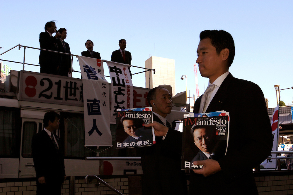"TOKYO-- OCT 30 2003- Before a rally for Naoto Kan head of the Democratic Party of Japan (DPJ)  largest Opposition Party to the Koizumi's Liberal Democratic Party( LDP) goverment,  Passes out Kan's ""Manifesto"" for  change."