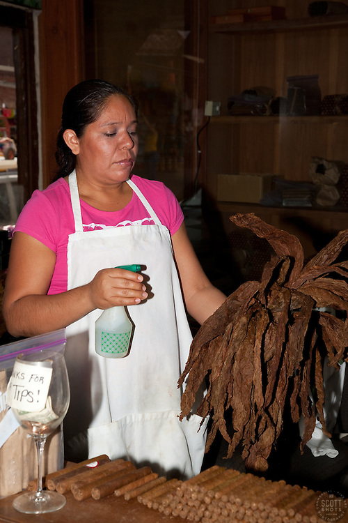 """Woman Making Cigars"" - This woman making cigars in a small cigar factory was photographed in Puerto Vallarta, Mexico."