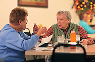 Lori La Shelle (from left) talks with Margaret Wilt, both of Thomson, as they eat supper at Dusty's Pizza Plus in Thomson, Illinois on Monday November 16, 2009. (Stephen Mally for The New York Times)