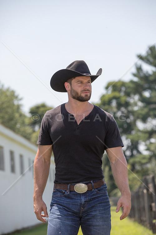 tough cowboy walking on a ranch