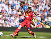 Blackburn Rovers player Craig Conway and Brighton defender full back Gaetan Bong tussle for possession during the Sky Bet Championship match between Brighton and Hove Albion and Blackburn Rovers at the American Express Community Stadium, Brighton and Hove, England on 22 August 2015. Photo by Bennett Dean.