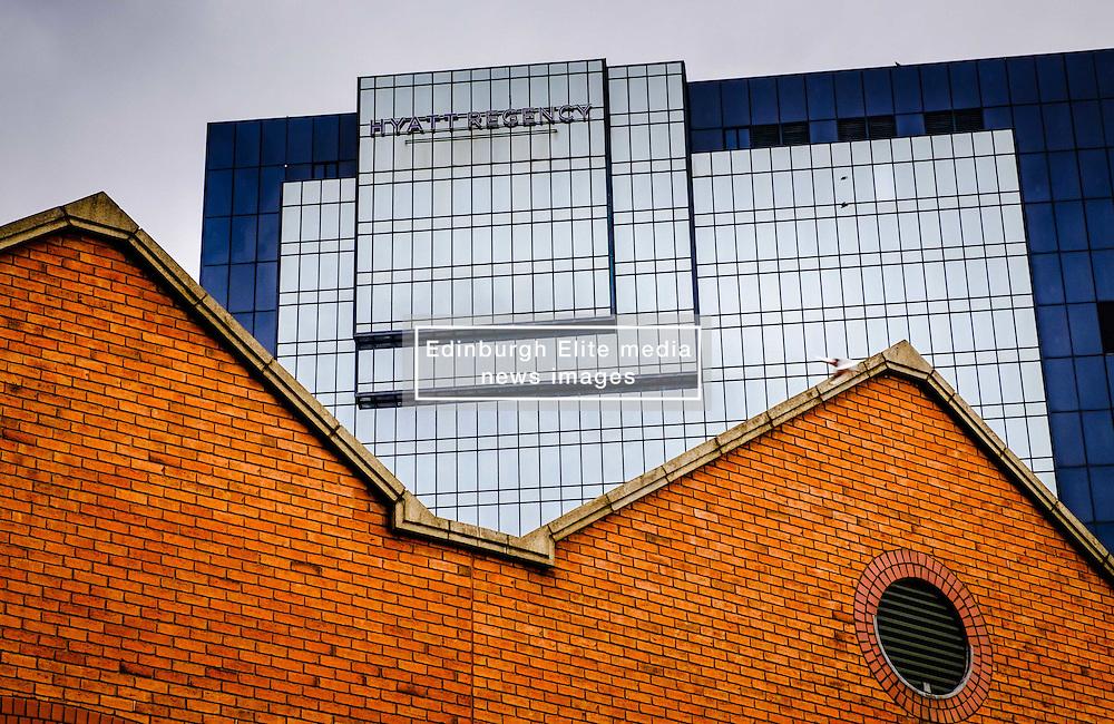 The modern Hyatt Regency hotel dwarfs old buildings by the canal in central Birmingham, England<br /> <br /> (c) Andrew Wilson   Edinburgh Elite media