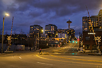 Given the constant traffic of cars, trucks, bicycles, trains, and people, this intersection is typically one of the busiest in Seattle most hours of the day. Also, notice that the Space Needle is not illuminated. It stands in darkness because it has been closed due to the coronavirus outbreak. (March 22, 2020)