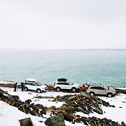 SUV's parked by one the dirt road next to the couloir Dalvik, Iceland