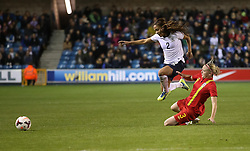 England's Alex Scott (Arsenal) tackled by Wales's Helen Bleazard - Chelsea - Photo mandatory by-line: Robin White/JMP - Tel: Mobile: 07966 386802 26/10/2013 - SPORT - FOOTBALL - The Den - Millwall - England Women v Wales Women - World Cup Qualifier - Group 6