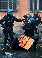 Roma 14 Dicembre 2010..Manifestazione contro il Governo Berlusconi. I manifestanti assaltono i mezzi della polizia  a Corso Rinasciamento..Rome December 14, 2010..Demonstration against the Berlusconi government. Protesters attack police  at Corso Rinasciamento.