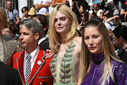 Elle Fanning and Director John Cameron Mitchell arriving on the red carpet of 'How to Talk to Girls at Parties' screening held at the Palais Des Festivals in Cannes, France on May 21, 2017 as part of the 70th Cannes Film Festival. Photo by Nicolas Genin/ABACAPRESS.COM