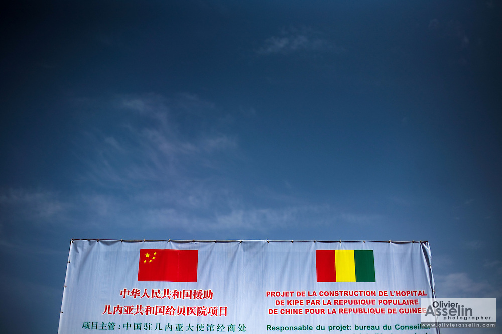 A sign in Chinese and French identifying the construction site of the Kipe hospital in Conakry, Guinea on Wednesday March 4, 2009. The Kipe hospital is a 10 million dollars project entirely funded by the Chinese government. (Olivier Asselin for the New York Times)