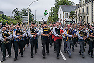The Triomphe des Sonneurs, a parade of nearly 600 musicians and over 800 dancers, at the conclusion of the Festival de Cornouaille on Sunday, July 24, 2016 in Quimper, France.