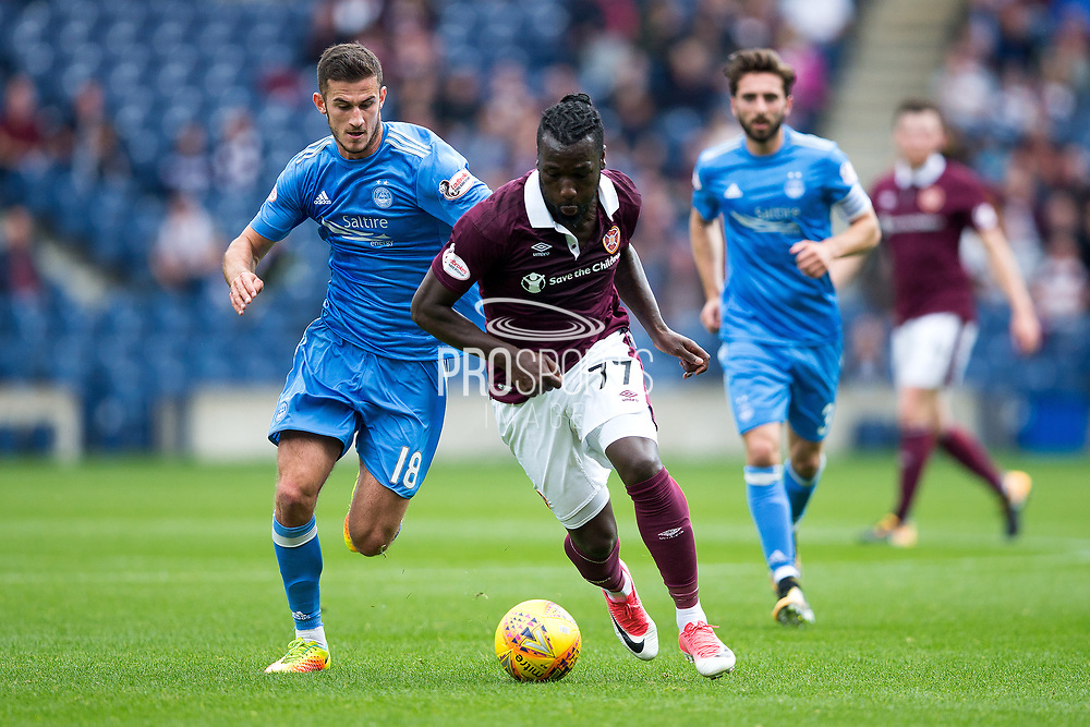 Aberdeen defender Dominic Ball (#18) and Heart of Midlothian forward Esmael Goncalves (#77) battle for possession of the ball during the Ladbrokes Scottish Premiership match between Heart of Midlothian and Aberdeen at Murrayfield, Edinburgh, Scotland on 9 September 2017. Photo by Craig Doyle.