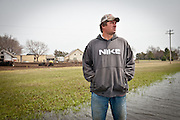 Jim Tarnick stands in a pool of standing water on his farm in Fullerton, Nebraska, at the exact location where the Keystone XL Pipeline is slated to cross his land.