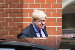 © Licensed to London News Pictures. 14/02/2018. London, UK. Foreign Secretary Boris Johnson leaves The Policy Exchange building by the back door after delivering his Valetine's Day 'Liberal Brexit' speech. Photo credit: Rob Pinney/LNP