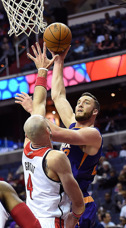 March 26, 2014 - Washington, DC, USA - Phoenix Suns center Miles Plumlee (22) shoots over Washington Wizards center Marcin Gortat (4) during the first half of their game played at the Verizon Center in Washington, Wednesday, Mar. 26, 2014