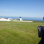 Fog horn requiem testing at Souter Lighthouse. Rehearsal with the Felling Band and 4 ships off shore. The Fog horn Requiem is a collaboration between Lise Autogena, Joshua Portway and Orlando Gough.
