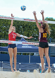 April 6, 2018 - Tucson, AZ, U.S. - TUCSON, AZ - APRIL 06: Arizona Wildcats blocker Kacey Nady (21) hits the ball during a college beach volleyball match between the Arizona State Sun Devils and the Arizona Wildcats on April 06, 2018, at Bear Down Beach in Tucson, AZ. Arizona defeated Arizona State 4-1. (Photo by Jacob Snow/Icon Sportswire (Credit Image: © Jacob Snow/Icon SMI via ZUMA Press)