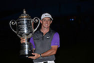 Rory McIlroy <br /> with the trophy after winning<br /> The US PGA Championship 2014, Valhalla, USA<br /> Picture Credit:  Mark Newcombe / visionsingolf.com