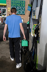 © Licensed to London News Pictures. 30/03/2012.Petrol Panic buying today 30.03.2012..Man filling a Jerry can at the BP garage on the A21 Lamberhurst Quarter, Kent..Photo credit : Grant Falvey/LNP