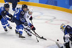 February 11, 2018 - Pyeongchang, KOREA - United States forward Gigi Marvin (19) battles Finland forward Riikka Valila (13) and shoots on goal at Finland goaltender Noora Raty (41) during women's hockey group A play during the Pyeongchang 2018 Olympic Winter Games at Kwandong Hockey Centre. The USA beat Finland 3-1. (Credit Image: © David McIntyre via ZUMA Wire)