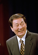 Chinese Premier Zhu Rongji laughs during a press conference with US President Bill Clinton at the White House April 8, 1999 in Washington D.C.