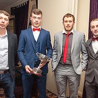 Diarmuid O'Leary, Ciaran Walsh, Noel Whelan and Kevin Brennan, members of the Éire Óg Senior B Football Team receiving their medals on the night