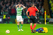 Kieran Tierney (#63) of Celtic FC can't believe that referee Javier Estrada Fernandez is booking him for a tackle on Matheus Cunha (#20) of RB Leipzig during the Europa League group stage match between Celtic and RP Leipzig at Celtic Park, Glasgow, Scotland on 8 November 2018.