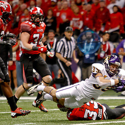 December 22, 2012; New Orleans, LA, USA; East Carolina Pirates wide receiver Danny Webster (33) dives over Louisiana-Lafayette Ragin Cajuns safety Trevence Patt (33) for a touchdown during the second quarter of the New Orleans Bowl at the Mercedes-Benz Superdome. Mandatory Credit: Derick E. Hingle-USA TODAY Sports