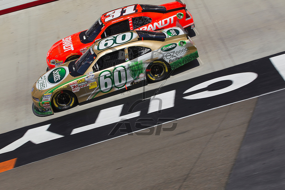BRISTOL, TN - MAR 19, 2011:  Carl Edwards (60) and Justin Allgaier (31) race for position during the Scotts EZ Seed 300 race at the Bristol Motor Speedway in Bristol, TN.