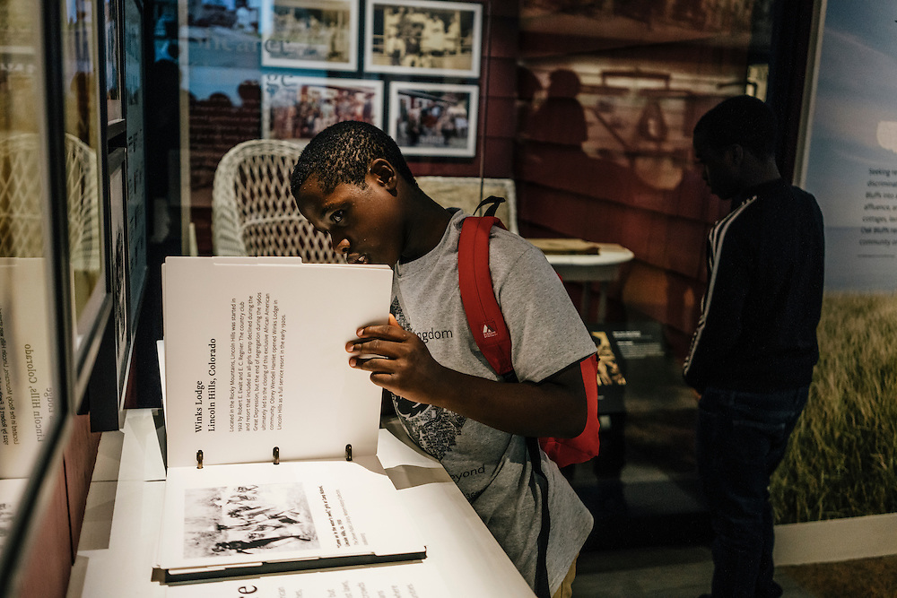 Sixth-graders from Knowledge Is Power Program (KIPP) DC, including Tay'sean Barrow, 12, center, look at an interactive display inside the Smithsonian National Musuem of African American History and Culture during their visit on Oct 21, 2016. The students spent an hour touring the new Washington, D.C. museum, which is only available to see with reserved tickets during the first year.
