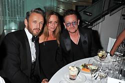 Left to right, ALASDHAIR WILLS, STELLA McCARTNEY and BONO at the GQ Men of The Year Awards 2012 held at The Royal Opera House, London on 4th September 2012.