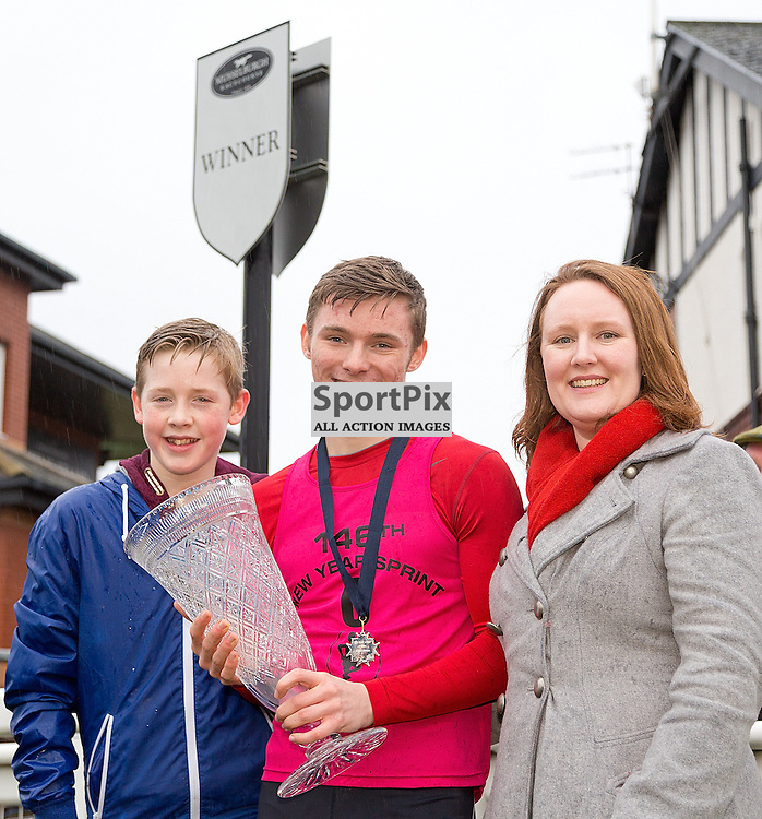 146th New Year Sprint 1 January 2015; Cameron Tindle, with his brother, Scott, and his mum, Eleanor, winner of the 146th New Year Sprint at Musselburgh Racecourse, Musselburgh;