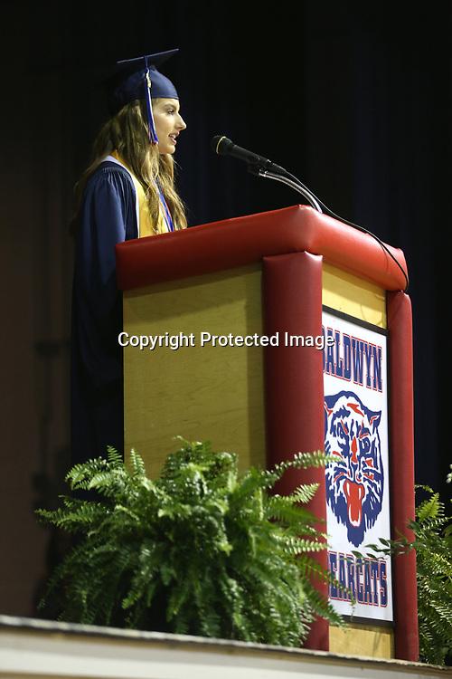Baldwyn High School senior co-valedictorian Ingrid Osmundson delivers her speech during Friday night's graduation ceremony at the school.