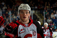 KELOWNA, BC - NOVEMBER 30: Josh Maser #11 of the Prince George Cougars celebrates a goal against the Kelowna Rockets with fist bumps along the bench during second period at Prospera Place on November 30, 2019 in Kelowna, Canada. (Photo by Marissa Baecker/Shoot the Breeze)